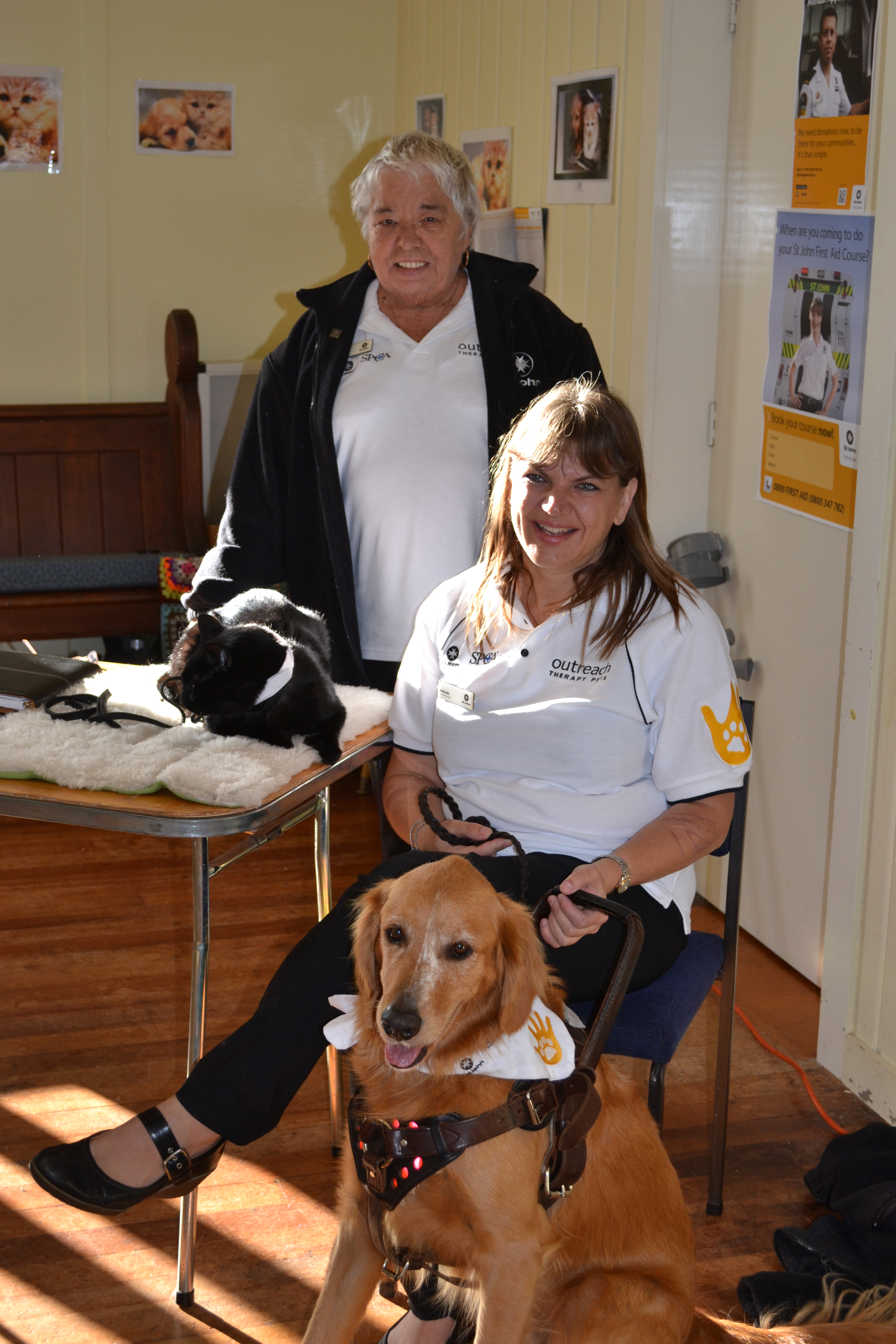 Sharon Mischefsky and Nunu the bull mastiff take time out during the Vodafone Warriors Emergency Services Heroes Day.